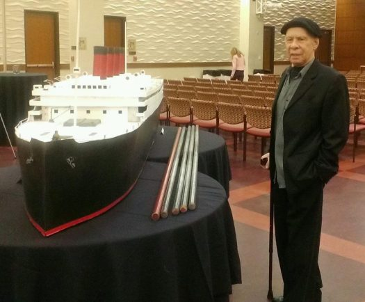 Rudy Perez Next to Ship and Poles USC Event