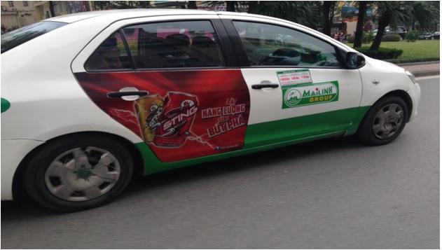 bao-gia-quang-cao-taxi-2-canh-cua