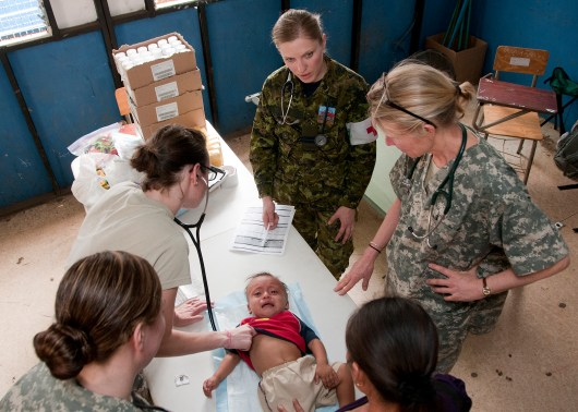CALUCO, El Salvador (April 15, 2013) — U.S. Air Force Capt. Alicia Prescott (examining), 959th Medical Group pediatrician, Lackland Air Force Base, examines a child during a medical clinic during Beyond the Horizon. Photo from US Southern Command