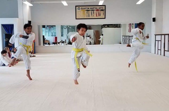 Quantum Kids jumping round kick