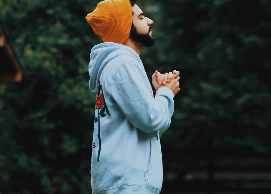 man wearing bonnet and hoodie