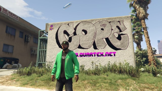 Frankling standing in front of the graffiti i made