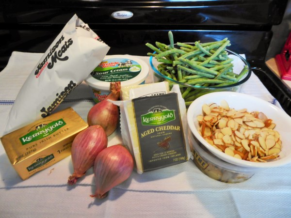 p1000383-2Ingredients for the whole meal, minus the potatoes and spices. Container below the almonds is filled with roasted garlic. Kerrygold Fresh Thyme