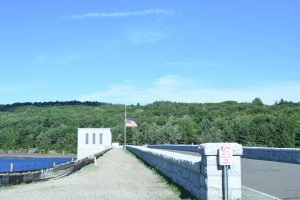 The Colebrook River Reservoir bridge, with the flag at half-mast on September 11th, 2016. (Photograph by Stephanie C. Fox)