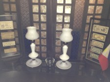 A pair of antique white-glass lamps along with entrance tickets to the now-long-defunct Manila Carnival.