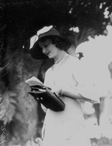 Vivienne Adams studying the form guide at Ascot races Brisbane December 1933
