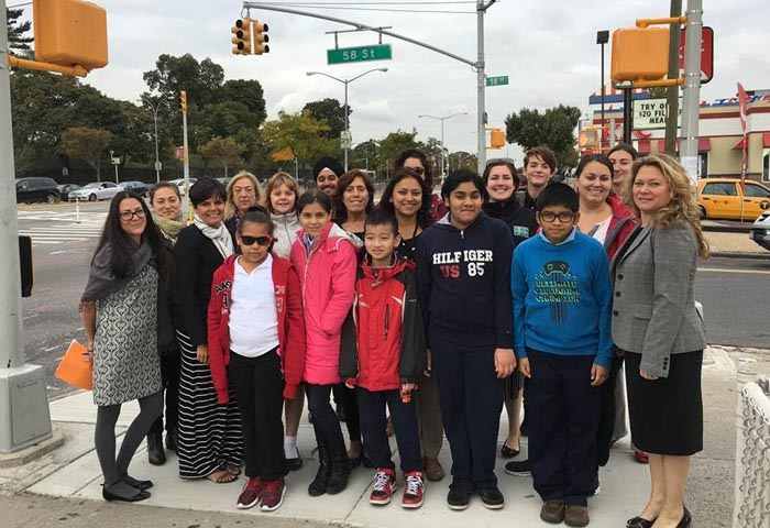 Queens Borough Commissioner Nicole Garcia, Assistant Commissioner for Education and Outreach Kim Wiley-Schwartz and Principal and students of PS 11 in Woodside, Queens celebrate International Walk to School Day along Queens Boulevard in the World's Borough.