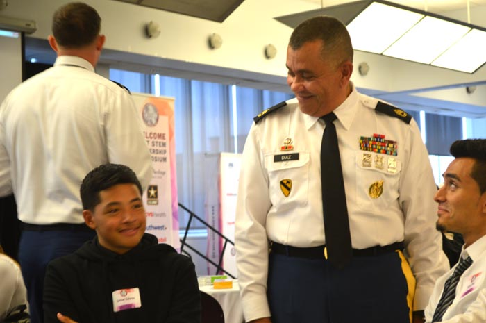 Sharing in a smiles and laughter during the leadership video vignettes, Sgt. 1st Class Julio Diaz, an Army recruiter of Puerto Rican descent, keeps the diverse group rolling along through the Army's presentation at Wednesday's LOFT event at Queens College in New York.
