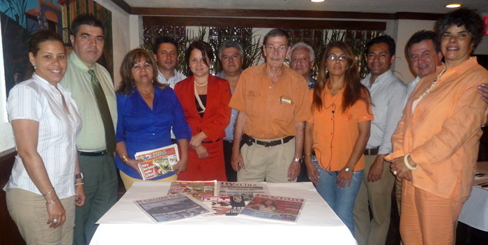 Carlos Velez in the restaurant La Pequeña Colombia of Queens with some members of the Hispanic Media Council.