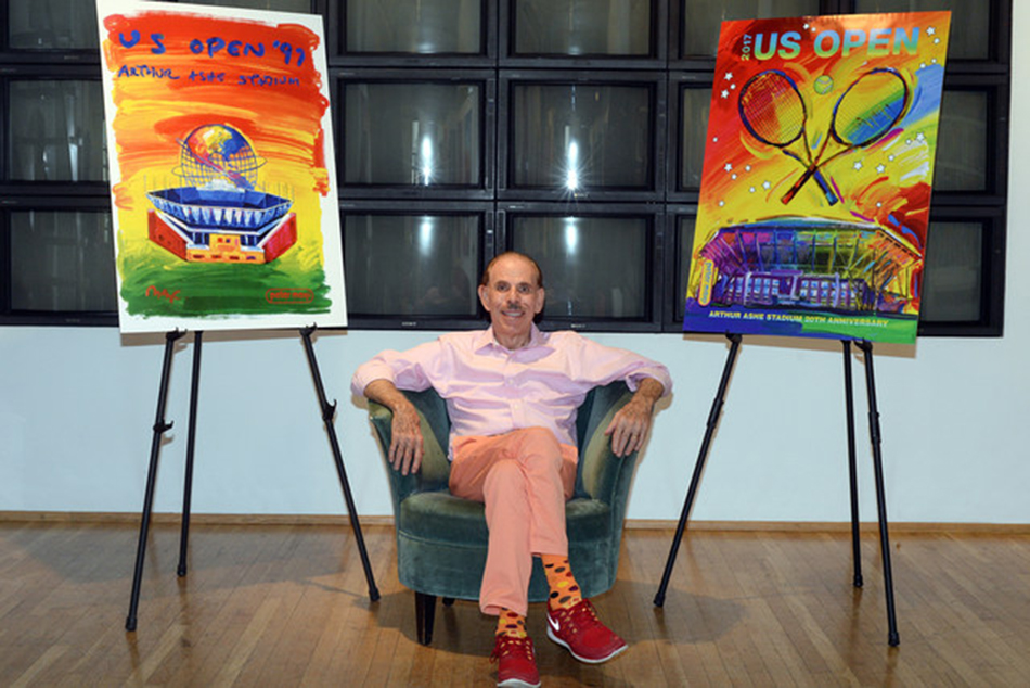Artist Peter Max poses with the original 1997 US Open theme art and the newly unveiled 2017 US Open theme art at Peter Max's studio in Manhattan, New York. Photo: Ashley Marshall/USTA