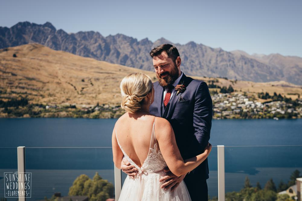 Bride and groom by The Remarkables and Lake