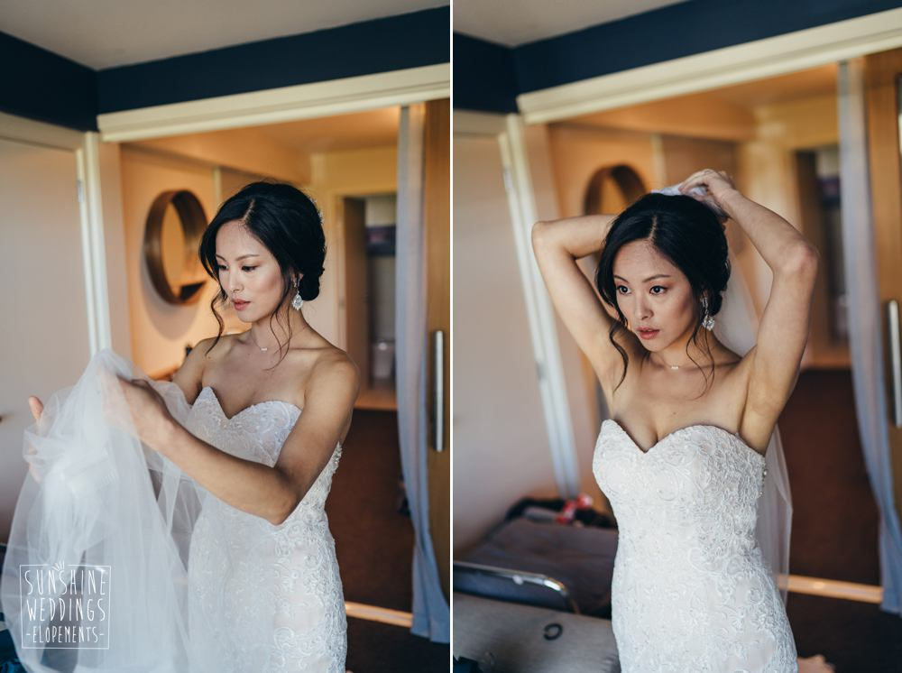 Bride putting on veil for Queenstown elopement