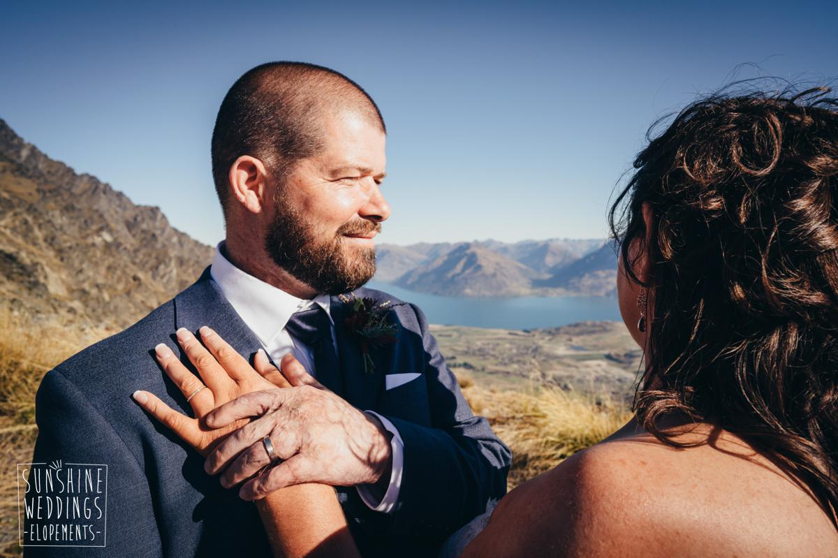 bride and groom on a New Zealand mountain