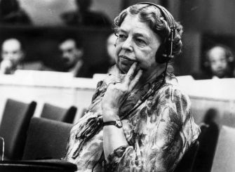 """Eleanor Roosevelt (1884 - 1962) American author, lecturer, ambassador, social activist and wife of the 32nd President Franklin D Roosevelt. A representative to the United Nations, she listens through headphones during a conference at the temporary UN headquarters at Lake Success, New York. President Truman called her """"First Lady of the World"""" because of her human rights achievements. (Photo by Keystone/Getty Images)"""