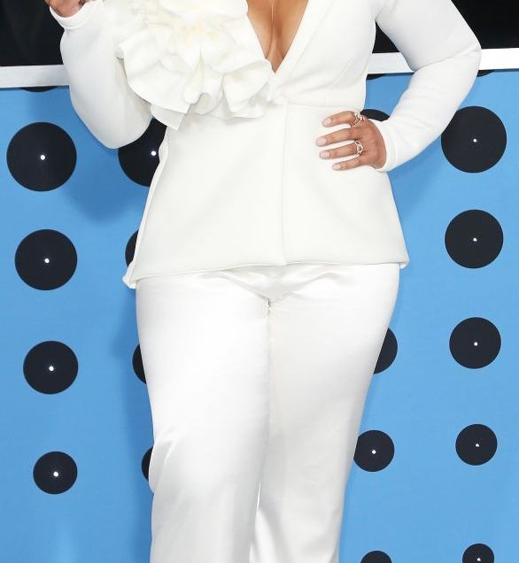 'Orange is the New Black' star, Dascha Polanco, looked stunning in all white. There aren't many people that can pull off the shoulder ruffle, but Dascha is in the number!