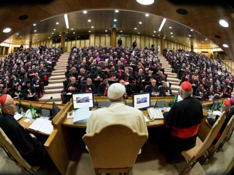 "A handout picture released by the Vatican press office show Pope Francis (C) chairing an extraordinary synod of nearly 200 senior clerics in the Synod Aula at the Vatican on October 6, 2014. Pope Francis issued a strong signal of support for reform of the Catholic Church's approach to marriage, cohabitation and divorce as bishops gathered for a landmark review of teaching on the family. Thorny theological questions such as whether divorced and remarried believers should be able to receive communion will dominate two weeks of closed-door discussions set to pit conservative clerics against reformists. AFP PHOTO / OSSERVATORE ROMANO == RESTRICTED TO EDITORIAL USE - MANDATORY CREDIT ""AFP PHOTO / OSSERVATORE ROMANO"" - NO MARKETING NO ADVERTISING CAMPAIGNS - DISTRIBUTED AS A SERVICE TO CLIENTS ==OSSERVATORE ROMANO/AFP/Getty Images"