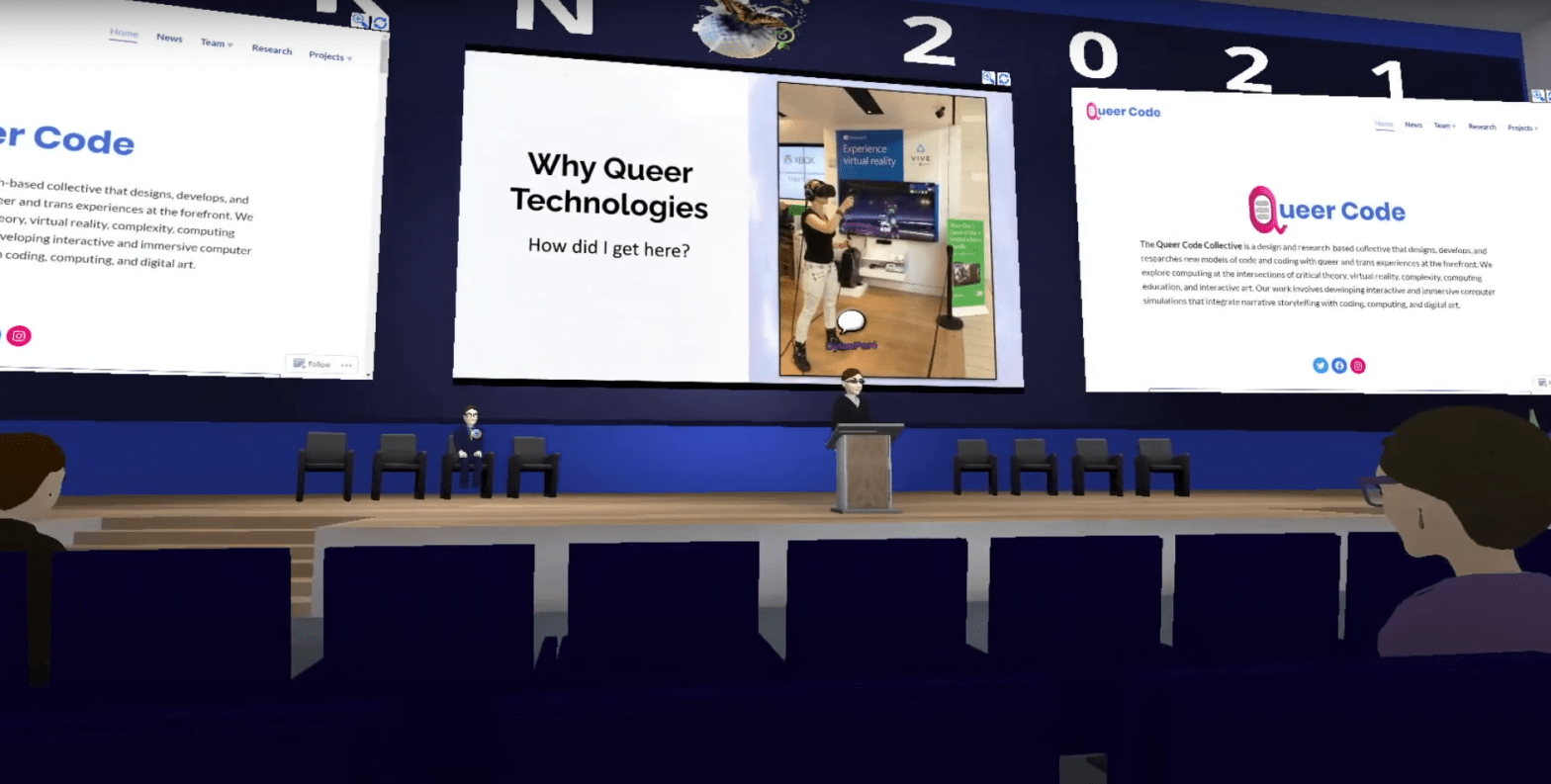Screen capture of iLRN talk in the Virbela virtual conference platform. Dylan is represented as an avatar on a stage with three large digital presentation screens behind them.