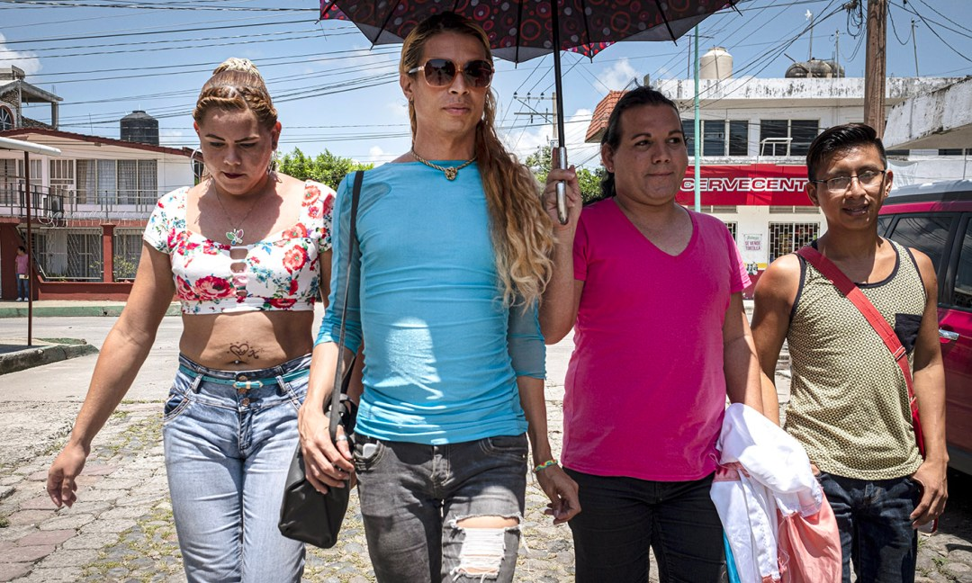 Kataleya, Lia, and Giovana, trans women who migrated to flee violence, run errands in the midday heat of Tapachula after picking up their hormones at Una Mano Amiga.