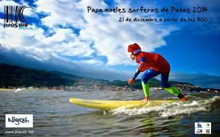 papa noeles surfeando