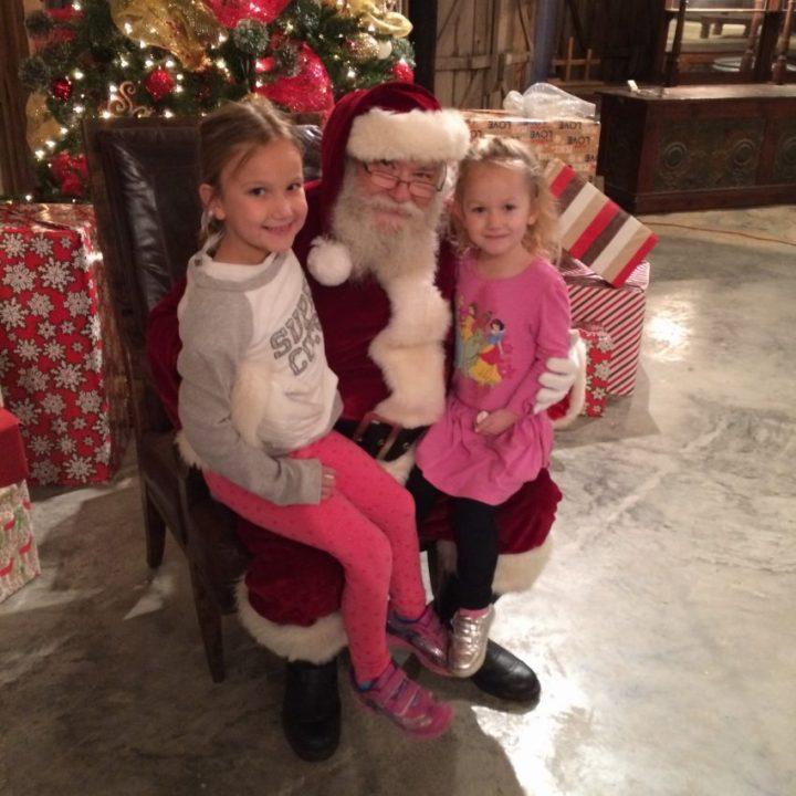 girls-visiting-santa-at-christmas-light-fest