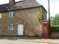 Fotheringhay - cottage and phone box with library and defibrillator