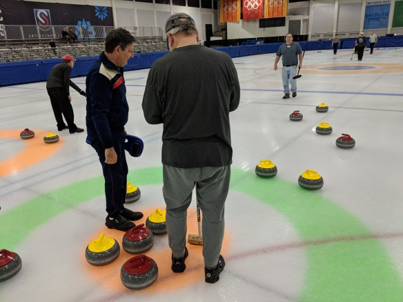 In the last shot of the final end of the winter 2018 Monday league, the yellow team faced a difficult shot to try to get their stone closest to the button on March 26, 2018, at the Utah Olympic Oval in Kearns.