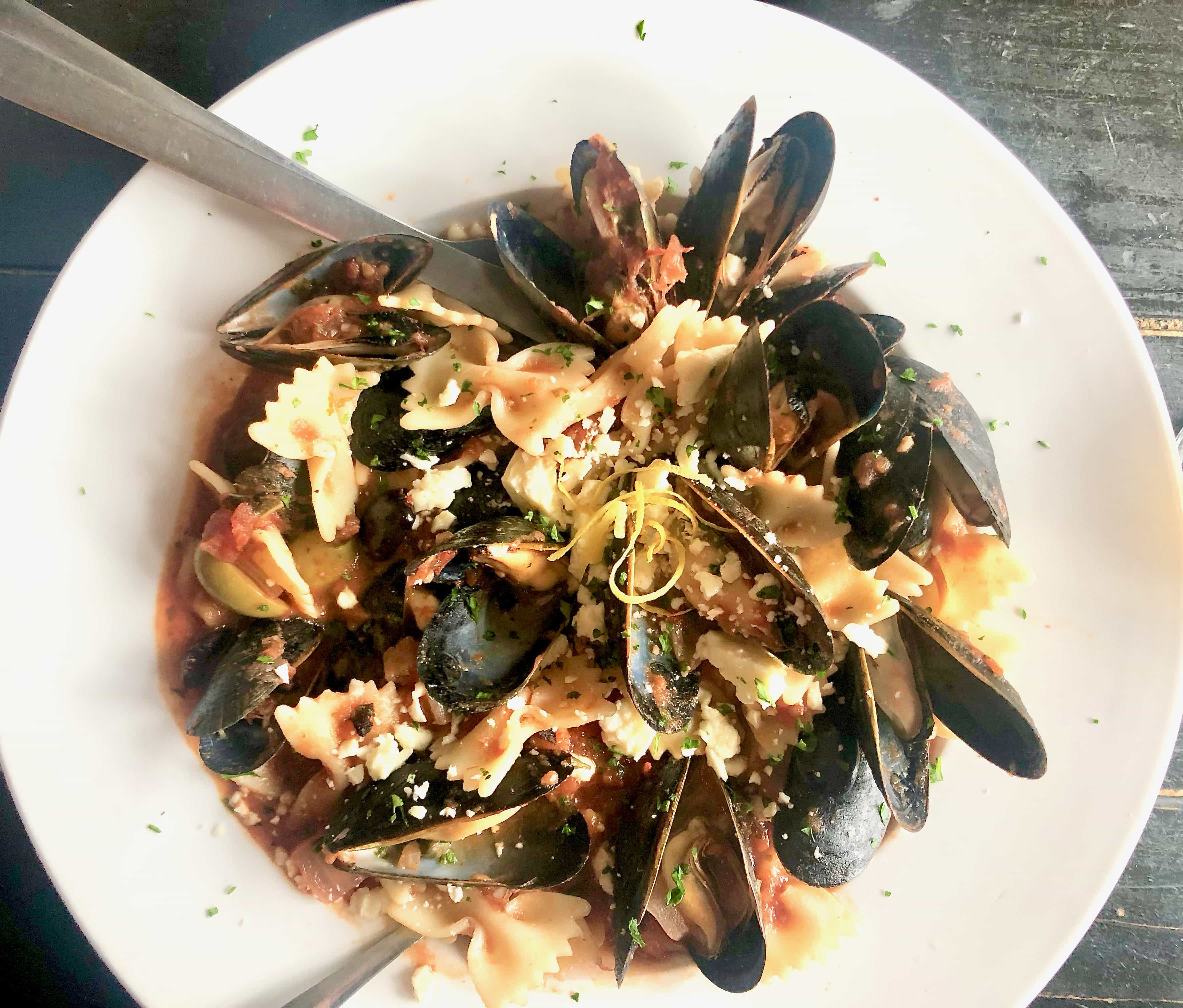 mussels on a white plate from Oyster House, Asheville NC