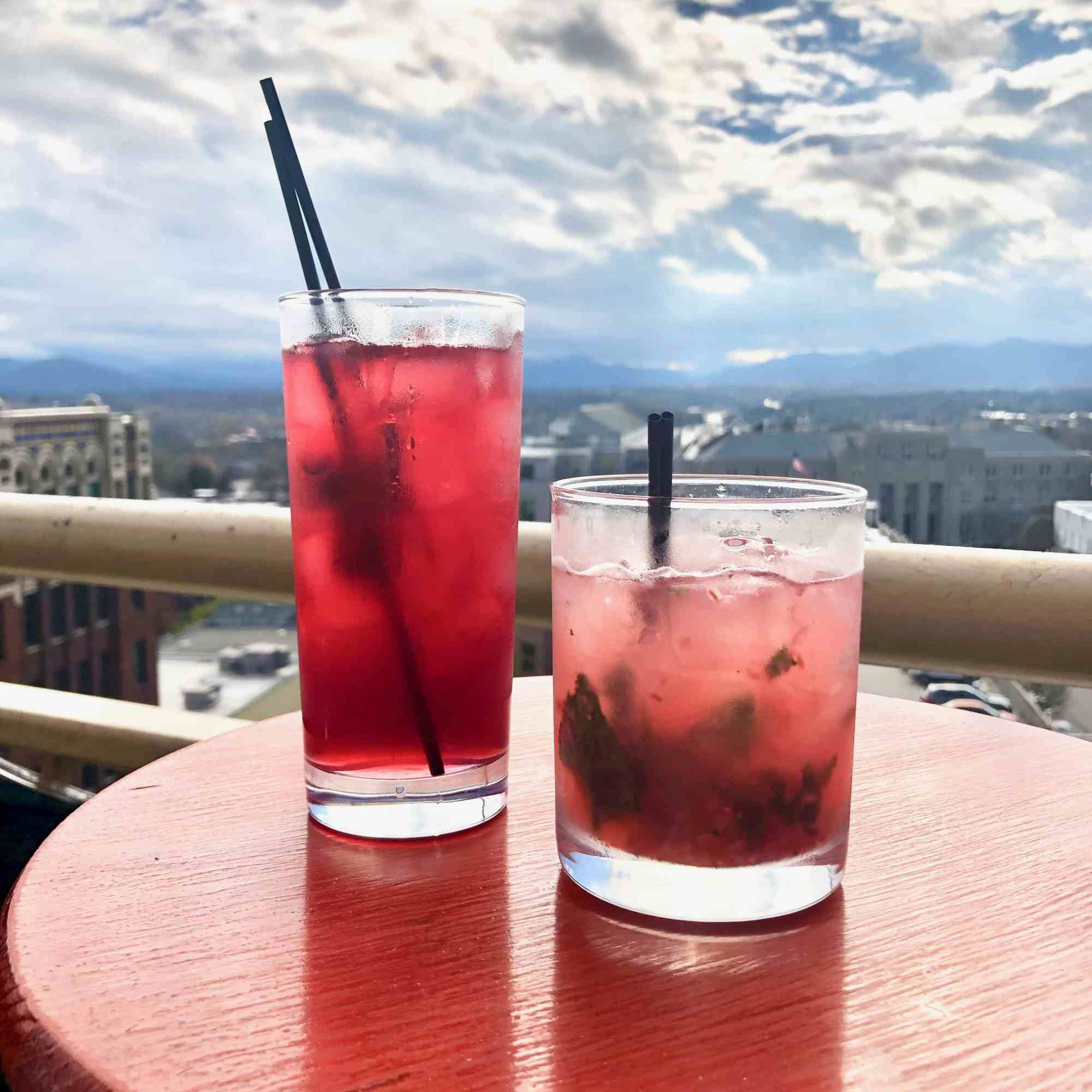 12 rooftop views in Asheville with drinks on a bar in Asheville NC overlooking mountains