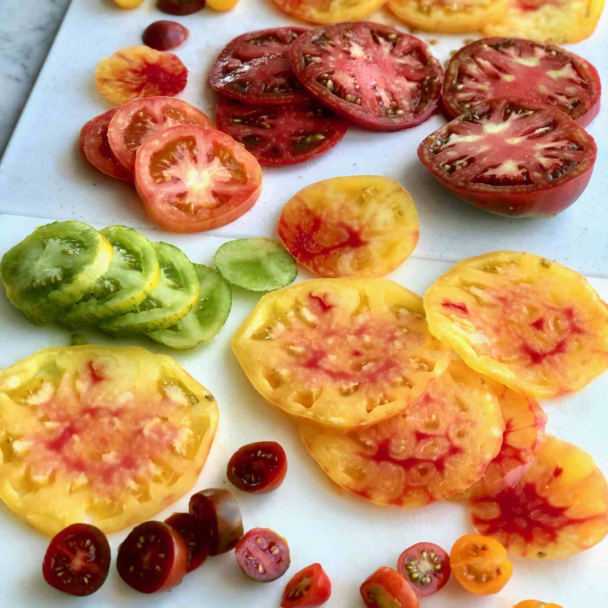 heirloom tomatoes on a cutting board