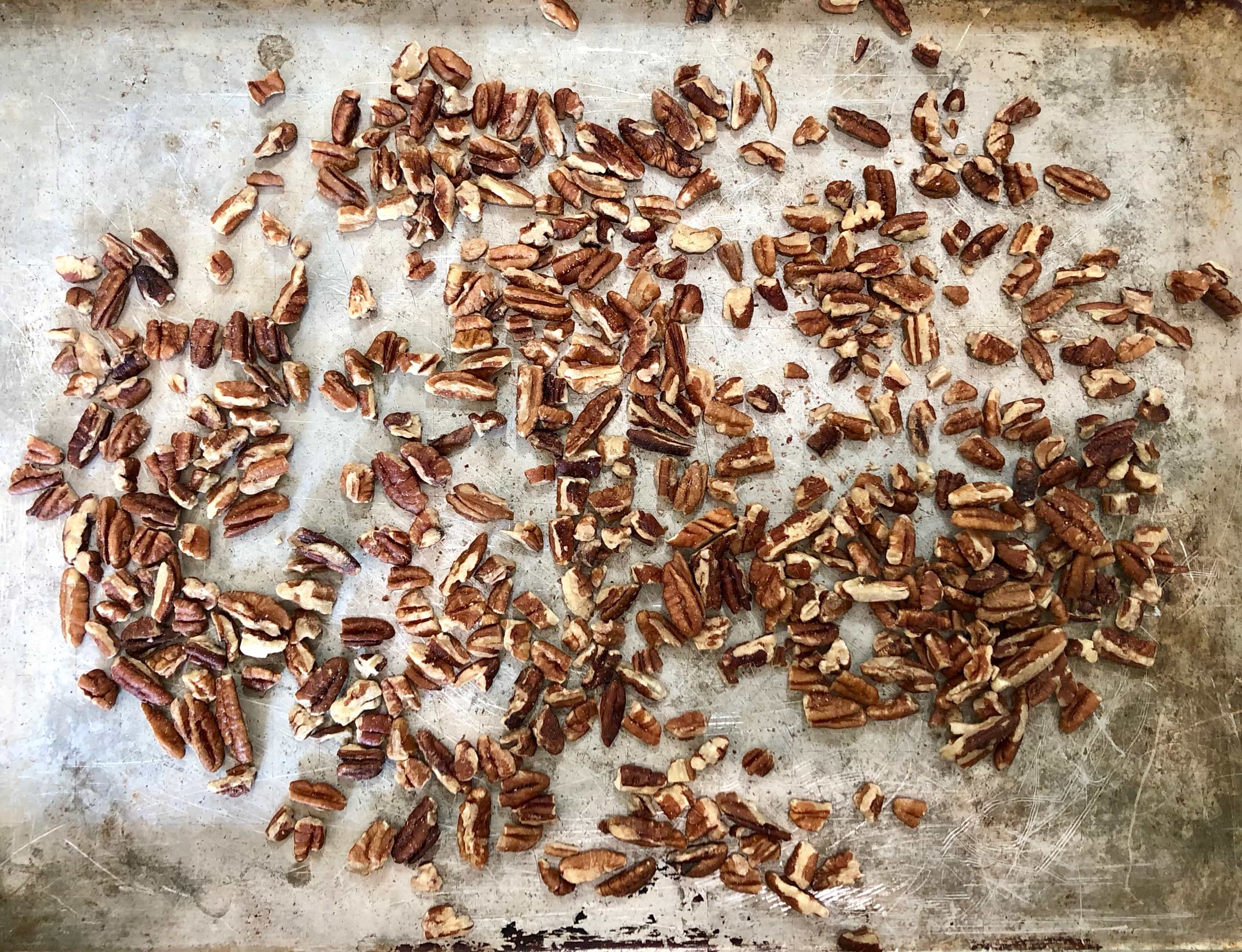 toasted pecans on a sheet pan