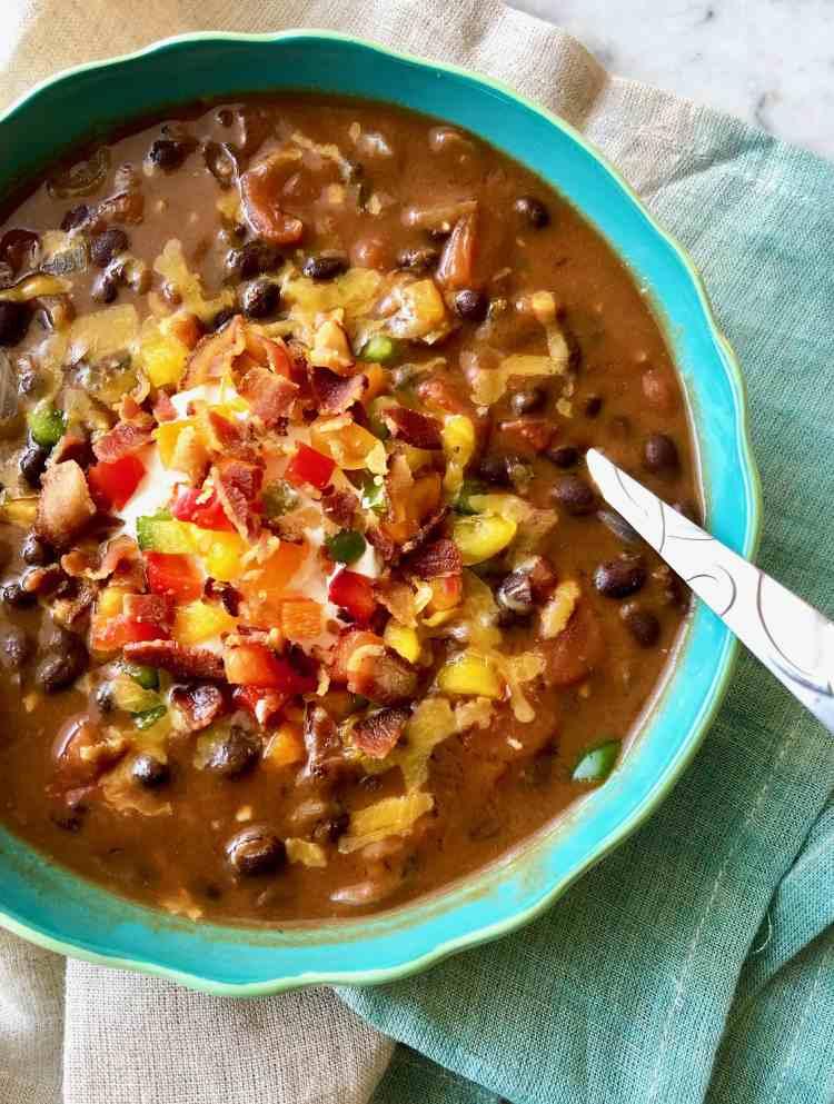 bacon black bean soup in a blue bowl