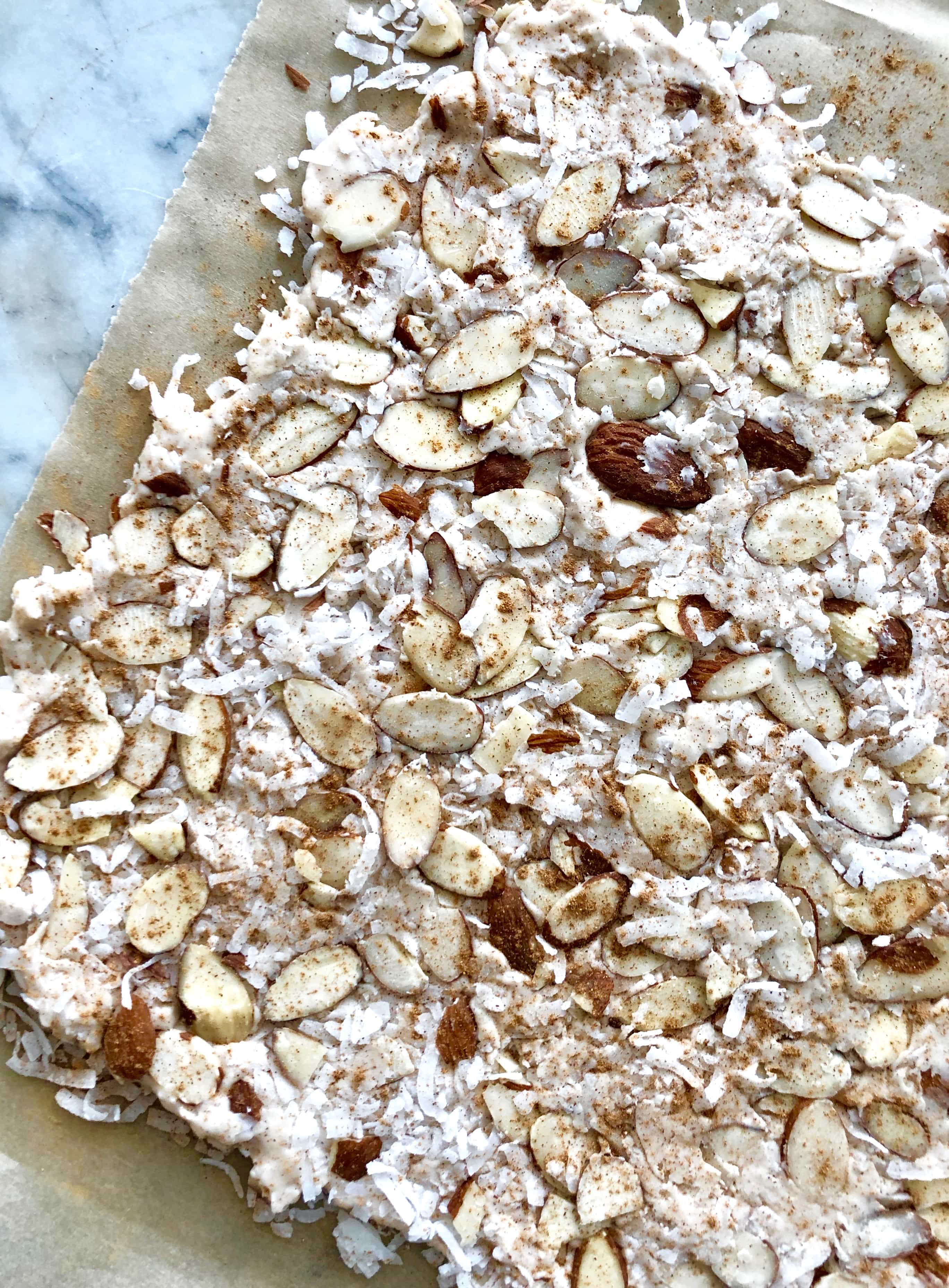 pumpkin spice coconut bark on parchment paper