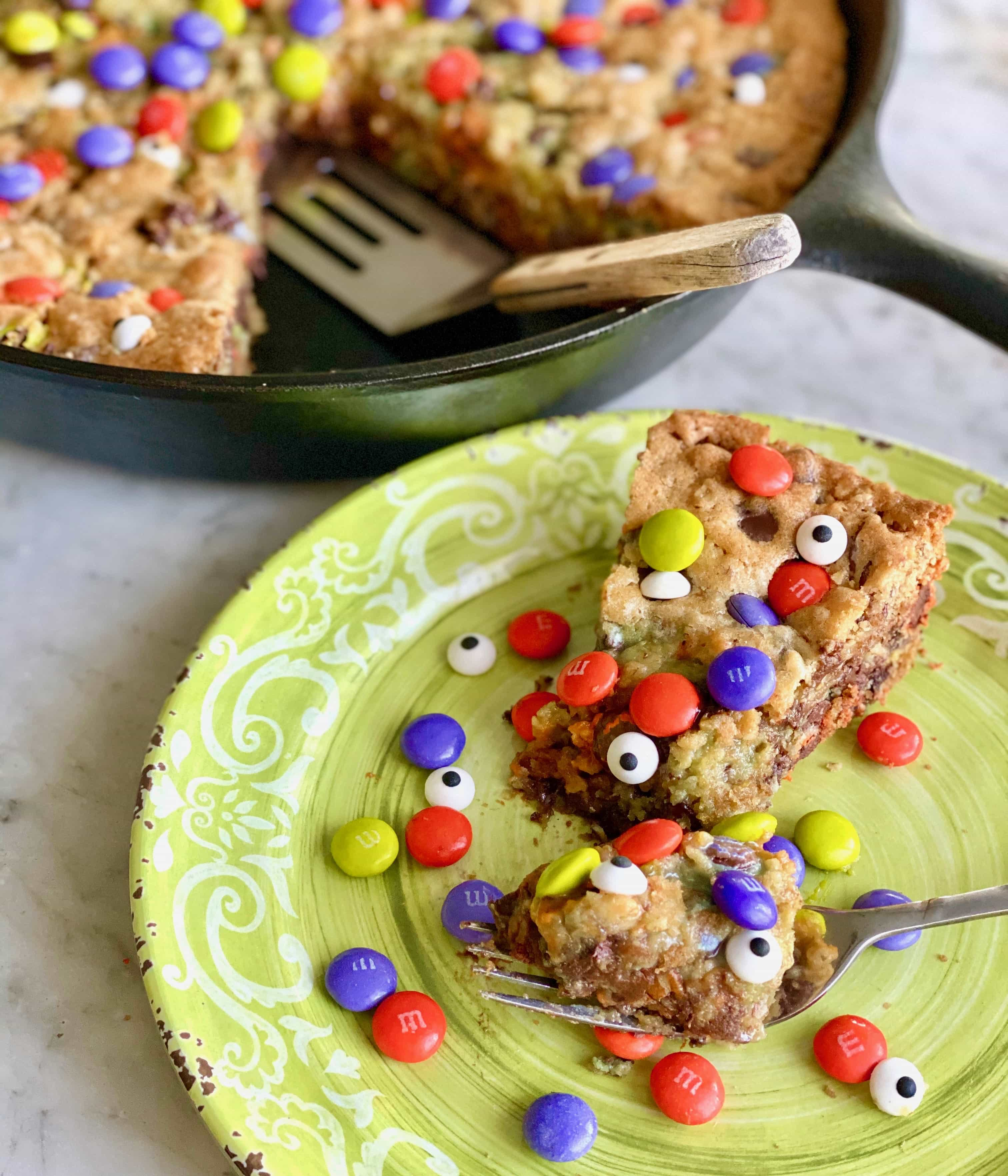 goblin skillet cookie on a green plate with candy eyeballs