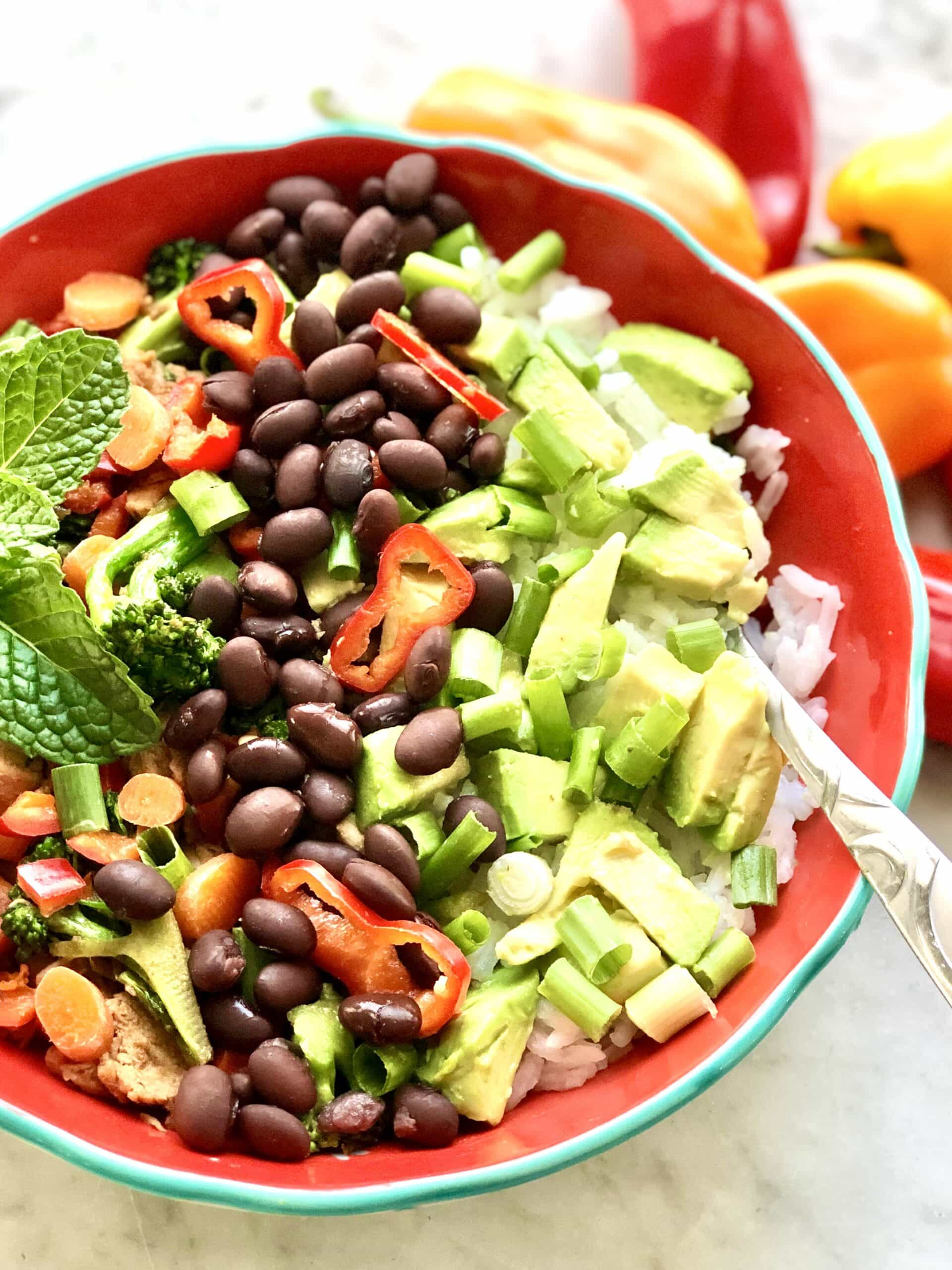 colorful fiesta rice bowl with avocado, black beans and chicken