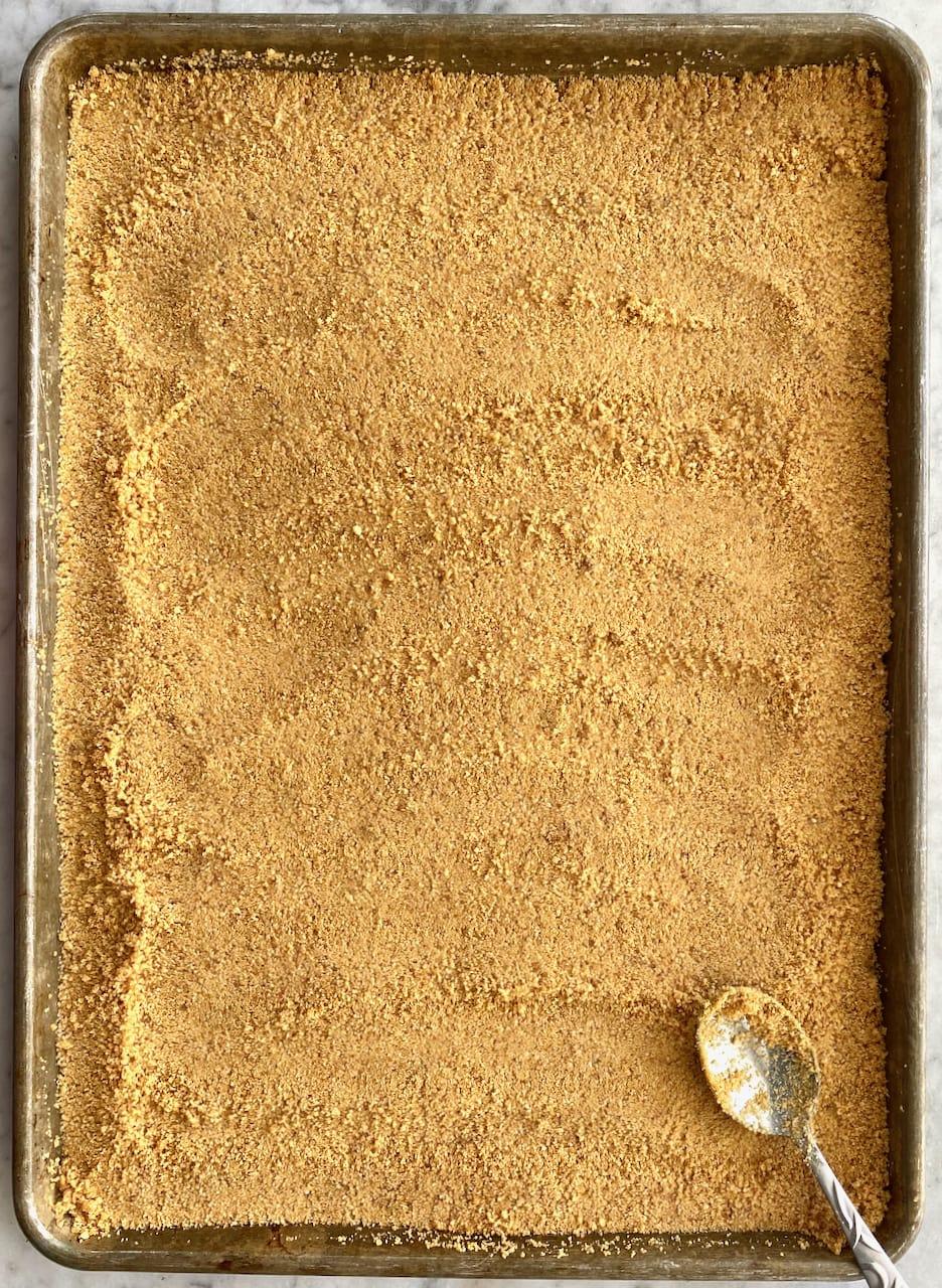 graham cracker crust on a sheet pan