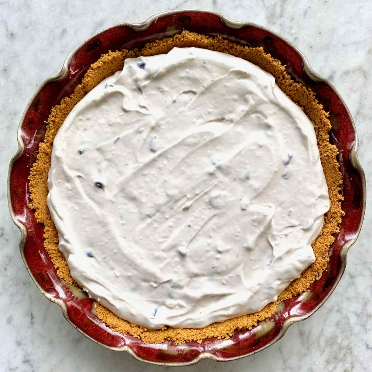 lemon blueberry pie in a graham cracker crust