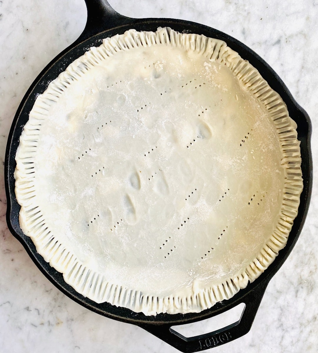 refrigerated pie dough pressed into a 12 inch cast iron skillet.