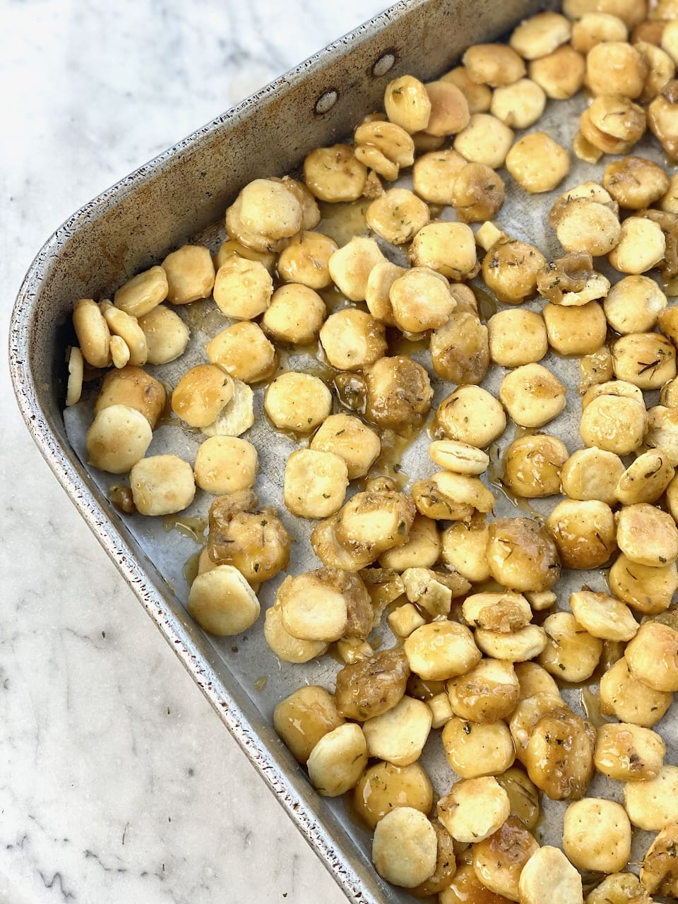 butter and sugar mixture poured over oyster cracker candy.