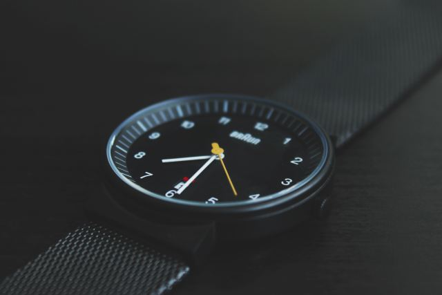 A black analog watch.