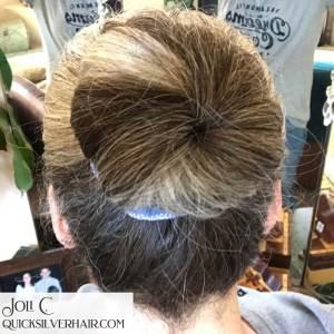 Image of woman with silver hair in a bun maker bun