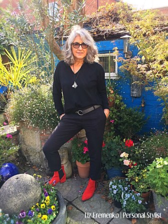 Image of Liz in all black with red boots in her garden