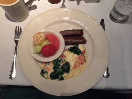 Omelette, fruit, and sausage