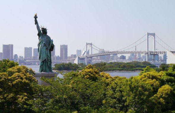 Replica Statue of Liberty in Odaiba, with Rainbow Bridge behind.