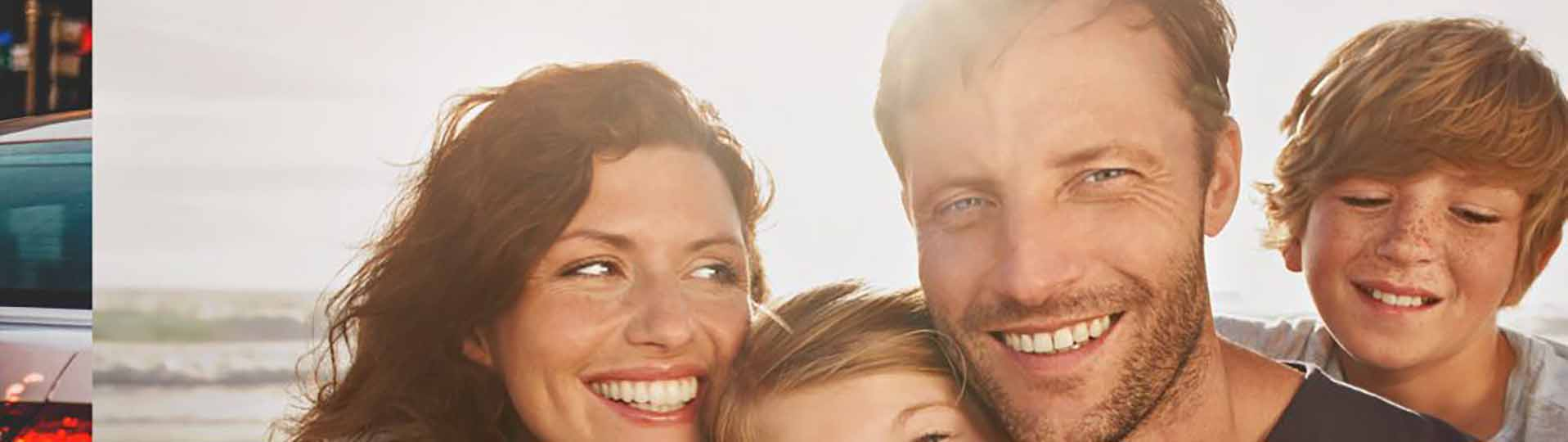 young family of 4 smiling