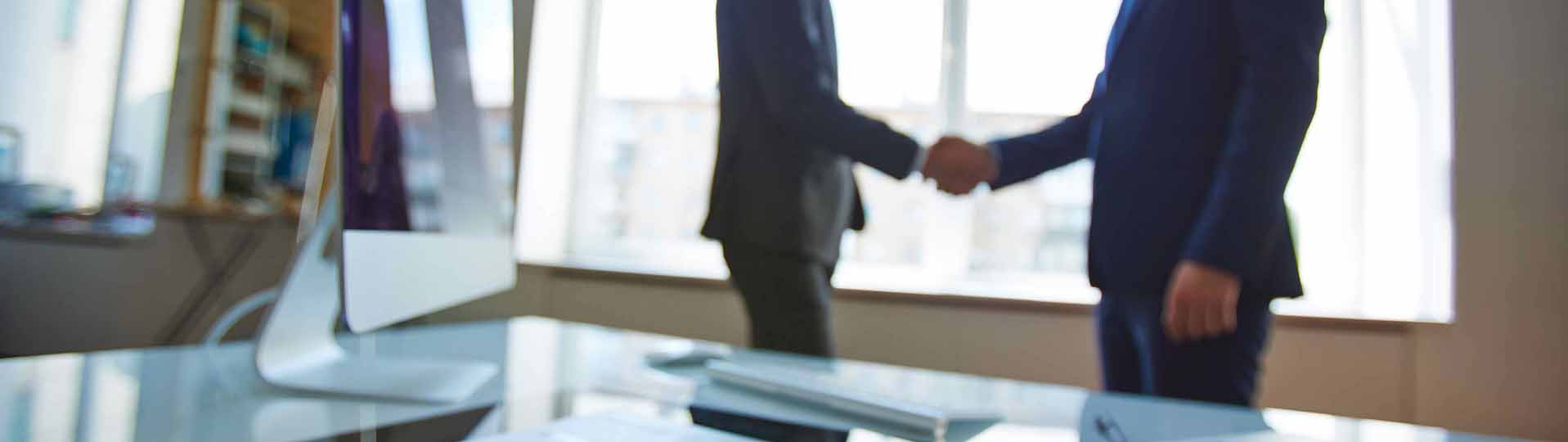 Investor Immigration Lawyers shaking hands