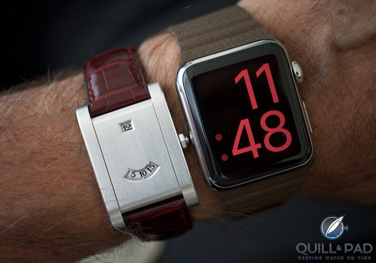 Two digital watches compared on the wrist: Cartier Tank à Guichets and Apple Watch