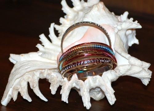 15 bangle bracelets in a seashell