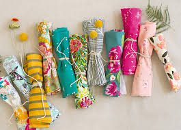 bright colored fabrics rolled and tied with string