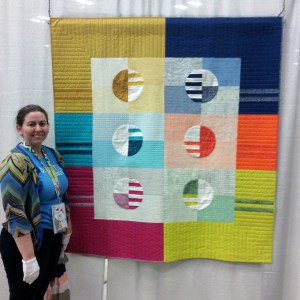 Michelle @Factotum of Arts with her Phased Circles Quilt