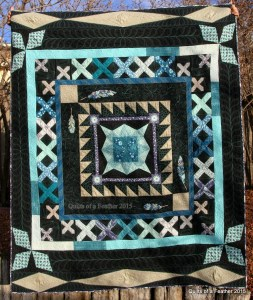 "Sisterhood of the Traveling Quilts finished quilt--titled ""Quilts of a Feather"""